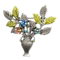 Image of bouquet in a vase brooch with yellow leaves and blue stones