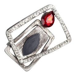 Image of modern silver brooch with red tear drop stone