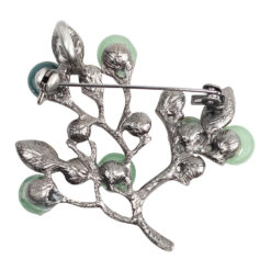 Back image of tree brooch with green stones and yellow leaves
