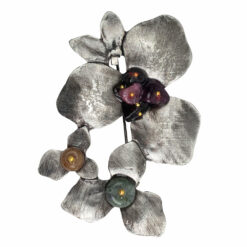 Image of flower brooch with violet, brown and green stones