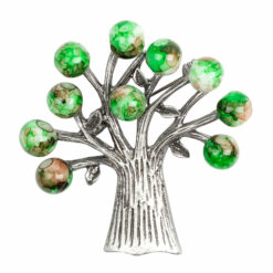 Photo of silver tree brooch with green stones