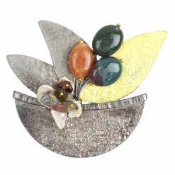 Image of silver basket brooch with yellow leaf and colourful stones