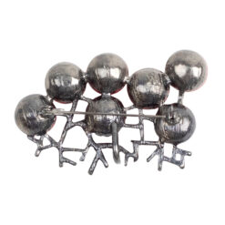 Back image of silver brooch with red stones