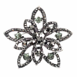 Image of silver flower brooch with green and grey stones