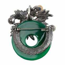 Back image of silver brooch with green stone