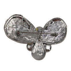Back image of silver and yellow flower brooch with stones