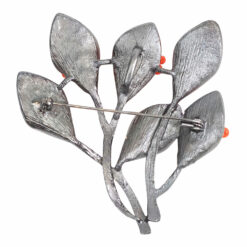 Back image of silver bouquet brooch with orange stones