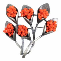 Image of silver bouquet brooch with orange stones