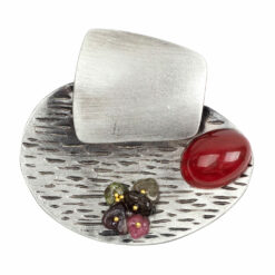 Image of silver oval stone brooch with red and green stones