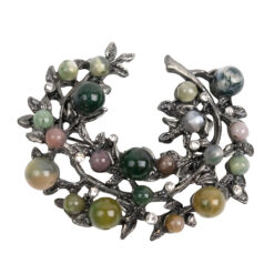 Image of silver wreath brooch with green and pink stones