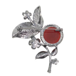 Back image of silver brooch with yellow leaves, pearls and red stone