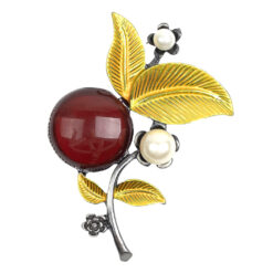 Image of silver flower brooch with pearls, yellow leaves and red stone