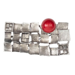 Image of rectangular silver brooch with red stone