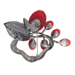 Back image of silver leaf brooch with red stones