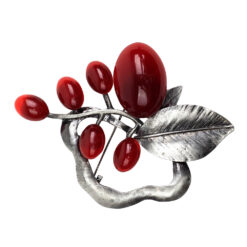 Image of silver brooch with leaves and red stones