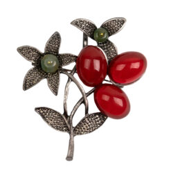Image of silver floral brooch with green and red stones