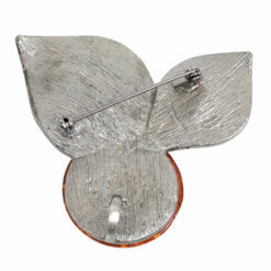 Image of silver brooch with orange stone