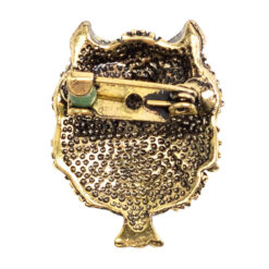 Back image of green owl brooch in gold setting