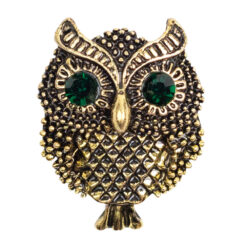 Image of gold brooch with green stones