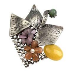 Image of silver retro brooch with yellow, lavender and green stones