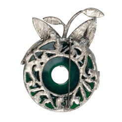 Close up photo of silver brooch with green stone