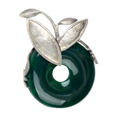 Image of round green brooch in silver setting
