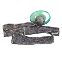 Back image of silver abstract brooch with green stone