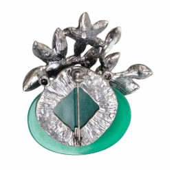 Image of silver flower brooch with green stone and pearls