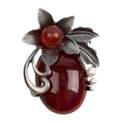 Image of silver flower brooch with red stones and pearls