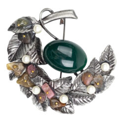 Image of silver brooch with leaves and green stone