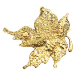 Back image of gold leaf brooch with colourful crystals